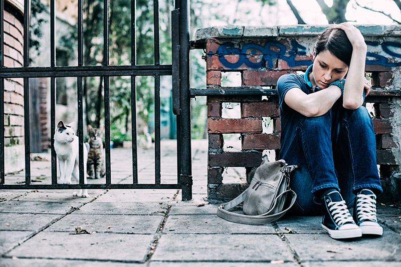 Depressed Girl Sitting Down on Sidewalk